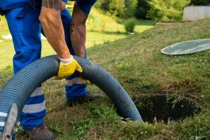 a man cleaning out a septic tank
