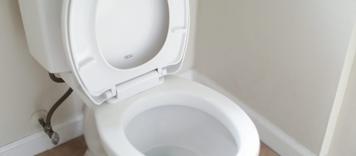 a toilet with a clogged drain